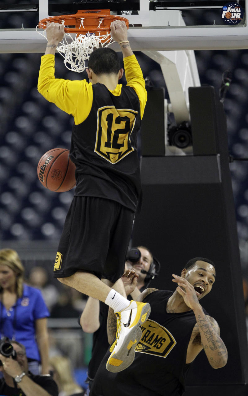 Virginia Commonwealth's Toby Veal helps Joey Rodriguez dunk during a practice for a men's NCAA Final Four semifinal college basketball game Friday, April 1, 2011, in Houston. VCU plays Butler on Saturday.  (AP Photo/Eric Gay)