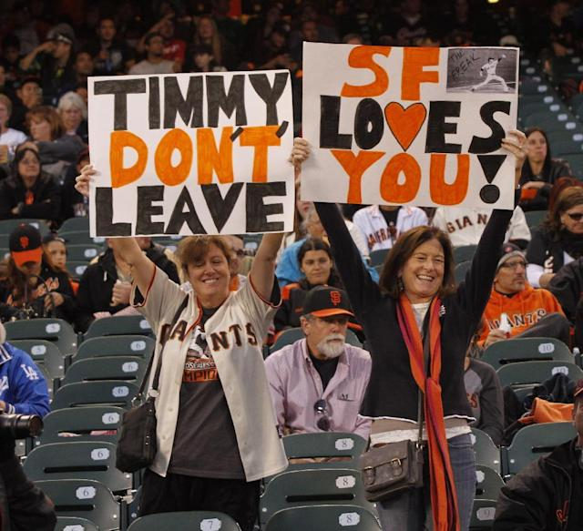 San Francisco Giants fans hold up signs for Giants' Tim Lincecum before the start of a baseball game against the Los Angeles Dodgers Thursday, Sept. 26, 2013, in San Francisco. (AP Photo/George Nikitin)