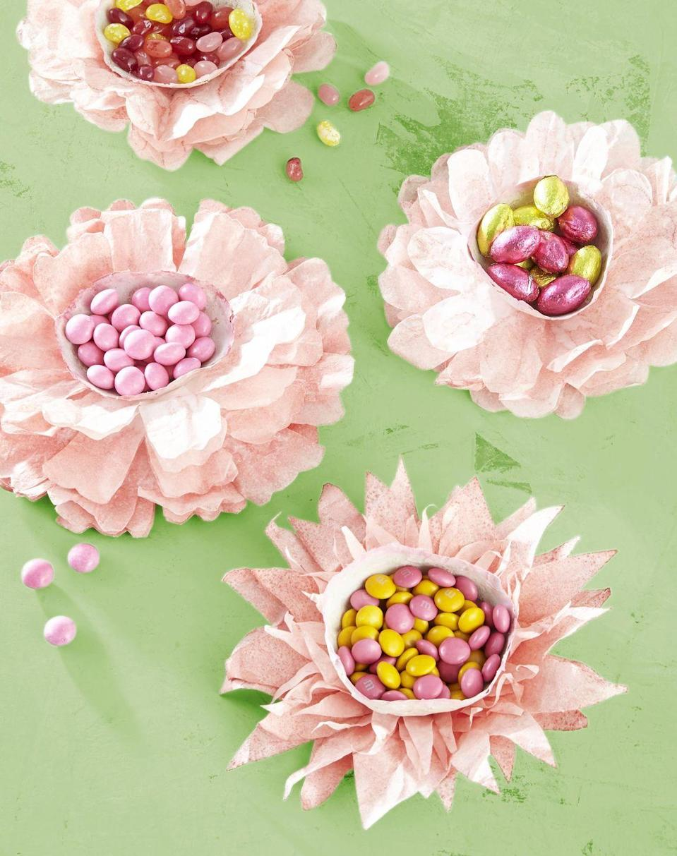 """<p>Make these flowering candy dishes with an item you probably already have in your house: coffee filters.</p><p><strong>To make:</strong> Submerge regular-size white coffee filters (you'll need four to six for each flower) in a watered-down Rit Dye solution (here, Petal Pink); dry completely. Cut into flower shapes of various sizes, and stack largest to smallest. Attach at centers with craft glue. Glue a papier-mâché or store-bought candy cup to center of each. Fill with candy.</p><p><a class=""""link rapid-noclick-resp"""" href=""""https://www.amazon.com/Rit-Dye-Liquid-Fabric-8-Ounce/dp/B0011455FY/ref=sr_1_2?tag=syn-yahoo-20&ascsubtag=%5Bartid%7C10050.g.1111%5Bsrc%7Cyahoo-us"""" rel=""""nofollow noopener"""" target=""""_blank"""" data-ylk=""""slk:SHOP RIT DYE"""">SHOP RIT DYE</a></p>"""