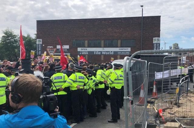Anti-Tommy Robinson protesters attempt to block a campaign van arriving on Douglas Place in Bootle, Merseyside