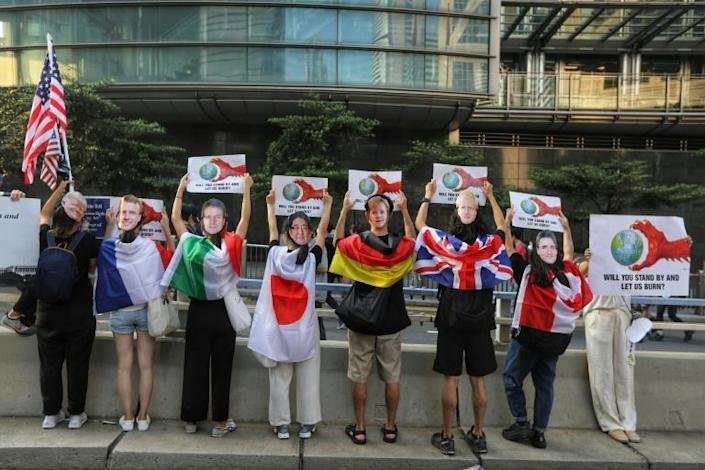 Some of the pro-democracy Hong Kong activists wore masks depicting various world leaders during the peaceful march to the US consulate, in a bid to increase pressure on China (AFP Photo/Vivek Prakash)