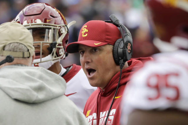 Southern Cal head coach Clay Helton talks with his players during an NCAA college football game against Washington Saturday, Sept. 28, 2019, in Seattle. (AP Photo/Elaine Thompson)