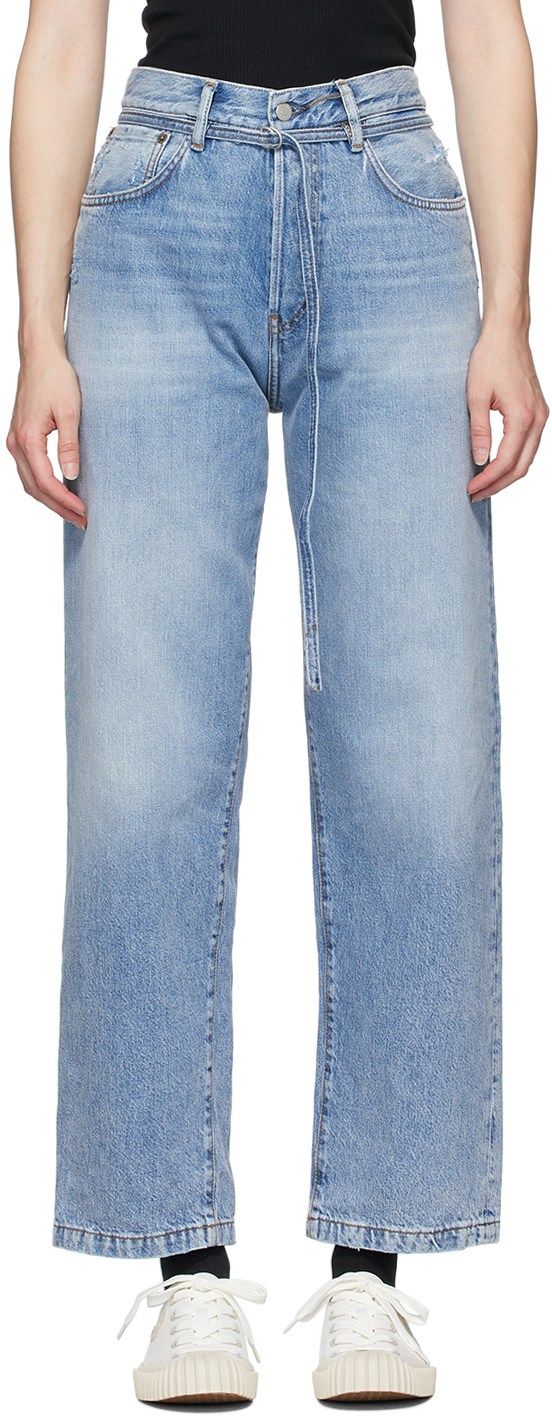 "<br><br><strong>Acne Studios</strong> Blue Blå Konst 1991 Vintage Trash Jeans, $, available at <a href=""https://go.skimresources.com/?id=30283X879131&url=https%3A%2F%2Fwww.ssense.com%2Fen-us%2Fwomen%2Fproduct%2Facne-studios%2Fblue-bla-konst-1991-vintage-trash-jeans%2F4737371"" rel=""nofollow noopener"" target=""_blank"" data-ylk=""slk:SSENSE"" class=""link rapid-noclick-resp"">SSENSE</a>"