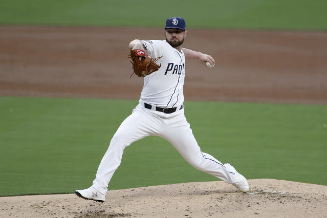 FILE - In this June 18, 2019, file photo, San Diego Padres starting pitcher Logan Allen works against a Milwaukee Brewers batter during the second inning of a baseball game, in San Diego. The Indians bulked up for the playoff race by trading temperamental starter Trevor Bauer before the deadline to Cincinnati in a three-team deal they hope can help them run down the Minnesota Twins. Cleveland, which trails the AL Central by three games but leads the wild-card race, sent Bauer to the Reds for slugger Yasiel Puig and left-hander Scott Moss. The Indians also acquired outfielder Franmil Reyes, lefty Logan Allen and infield prospect Victor Nova from the San Diego Padres, who acquired outfielder Taylor Trammel from the Reds.(AP Photo/Gregory Bull)
