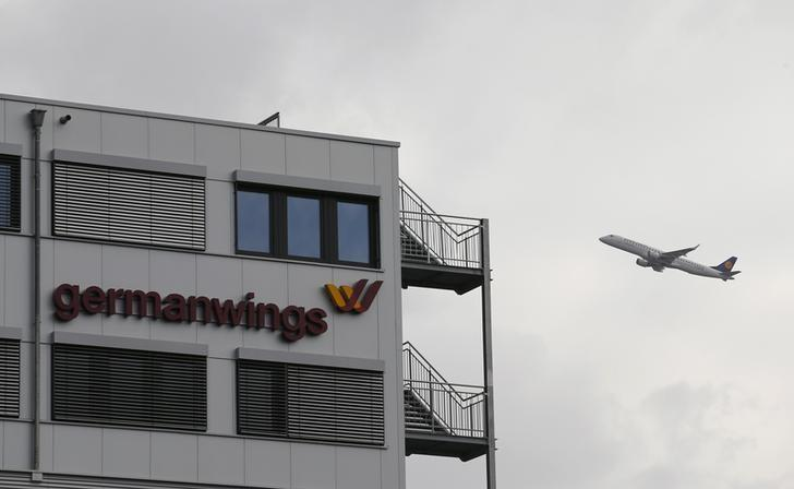 Lufthansa aircraft flies past the headquarters of Germanwings during take-off from Cologne-Bonn airport