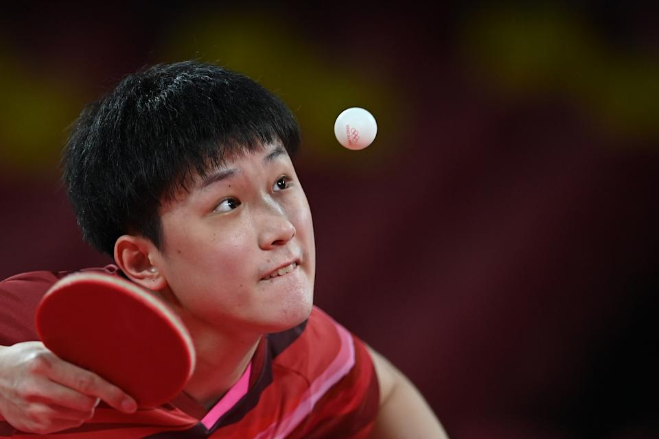 <p>Japan's Tomokazu Harimoto competes against Sweden's Anton Kaellberg during their men's team quarterfinals table tennis match Japan vs Sweden at the Tokyo Metropolitan Gymnasium during the Tokyo 2020 Olympic Games in Tokyo on August 3, 2021. (Photo by JUNG Yeon-je / AFP)</p>