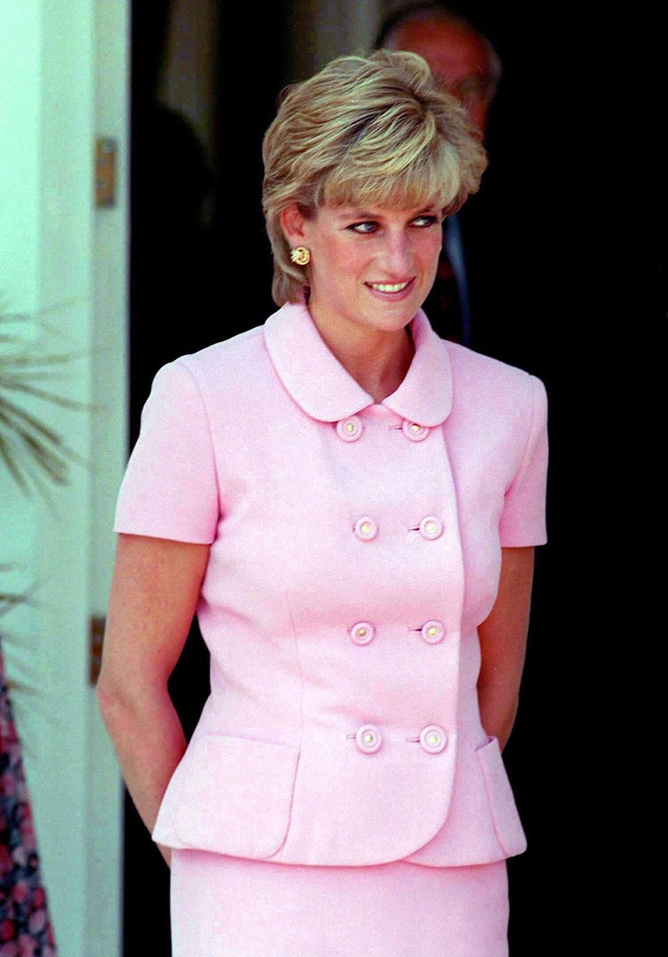 <p>Here, the Princess of Wales wears a powder pink suit. She finished the look with a feathered hairstyle. <em>[Photo: PA]</em> </p>