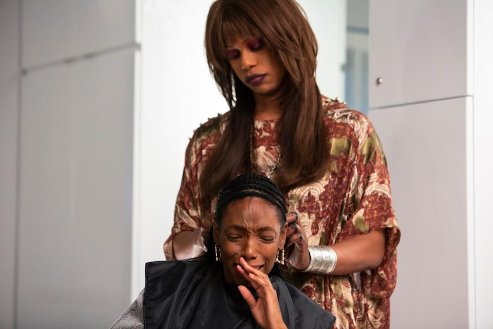 """Virgie (Laverne Cox, standing) gives Anna (Elle Lorraine) a weave that has a mind of its own in the 1989-set horror satire """"Bad Hair."""""""