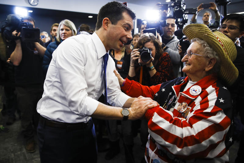 Democratic presidential candidate former South Bend, Ind., Mayor Pete Buttigieg meets with Pat Provencher during a campaign event, Monday, Feb. 10, 2020, in Plymouth, N.H. (Matt Rourke/AP)