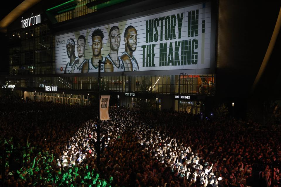 Fans watch television coverage of the Milwaukee Bucks and Phoenix Suns playing in Game 6 of the NBA basketball finals Tuesday, July 20, 2021, in Milwaukee. (AP Photo/Jeffrey Phelps)