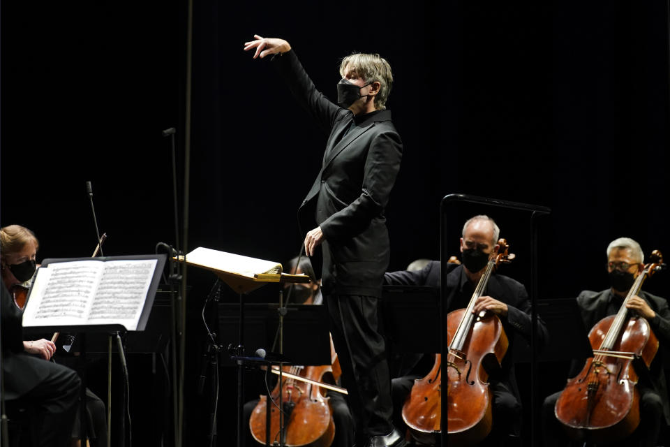 CORRECTS SPELLING OF FIRST NAME TO ESA INSTEAD OF ESSA - Guest conductor Esa-Pekka Salonen, music director of the San Francisco Symphony and principal conductor of London's Philharmonia Orchestra, leads the New York Philharmonic as the orchestra perform together before a live audience of 150 people for the first time since March 10, 2020, at The Shed in Hudson Yards, Wednesday, April 14, 2021, in New York. (AP Photo/Kathy Willens)
