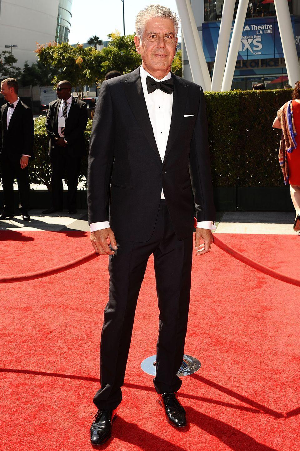 <p>In 2013, Bourdain moved to CNN to host <em>Parts Unknown</em>, a travel show that focuses on food, culture, and politics. That show is still on the air. Here, Bourdain attends the Emmy Awards in L.A. on September 15, 2013. He's won four Emmy awards for <em>Parts Unknown</em>. </p>