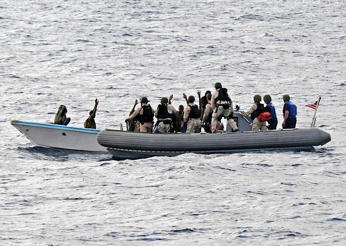 A US Navy search and seizure team members apprehend suspected pirates in the Gulf of Aden (AFP Photo/Jason R. Zalasky)