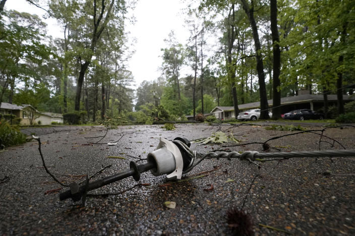 This downed utility line from a fallen tree in a northeast Jackson, Miss., neighborhood, was not an unfamiliar sight following a bout of high winds and severe weather, Tuesday afternoon, May 4, 2021. The severe weather was not unexpected, since the state was hit with a number of tornadoes on Sunday. (AP Photo/Rogelio V. Solis)