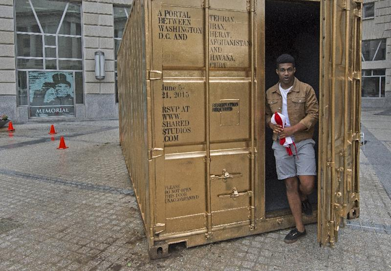 An man emerges from the Golden Shipping Container after making a free video call in the courtyard of the Woodrow Wilson Building in Washington, DC on June 5, 2015 (AFP Photo/Paul J. Richards)