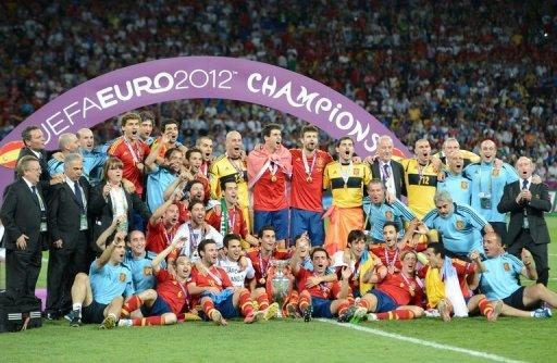 Spanish players pose with the trophy after winning the Euro 2012 football championships final match Spain vs Italy at the Olympic Stadium in Kiev. Spain won 4-0