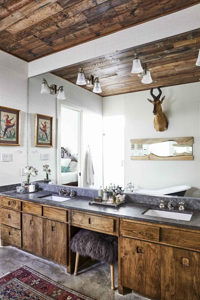 "<p>The Scandinavian-inspired bathroom of Homepolish designer <a href=""https://www.elledecor.com/design-decorate/house-interiors/news/a9471/scandinavian-design-bohemian-style/"" target=""_blank"">Erika Yeaman's home</a> features dual sinks.  </p>"