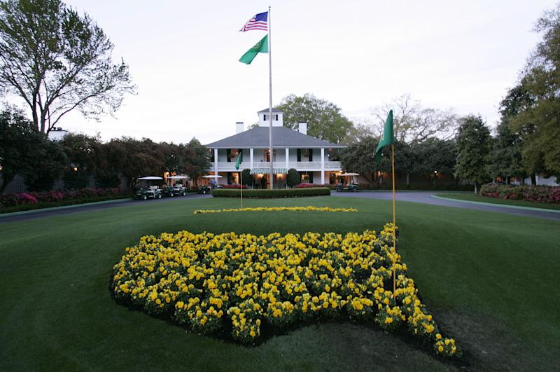 FILE - This April 5, 2006 file photo shows bright yellow flowers in the shape of the United States adorn the lawn at the clubhouse during practice for the 2006 Masters golf tournament at the Augusta National Golf Club in Augusta, Ga. For the first time in it's 80-year history, Augusta National Golf Club has female members. The home of the Masters, under increasing criticism the last decade because of its all-male membership, invited former Secretary of State Condoleeza Rice and South Carolina financier Darla Moore to become the first women in green jackets when the club opens for a new season in October. (AP Photo/David J. Phillip, File)