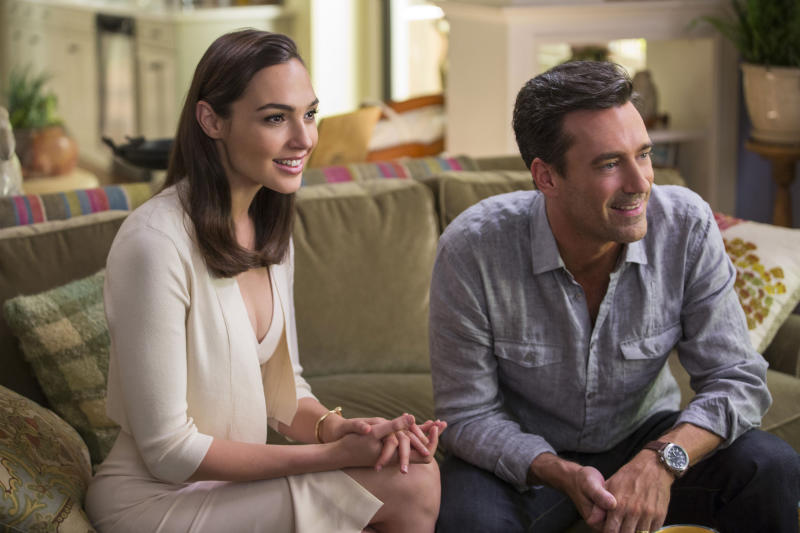 """This image released by Twentieth Century Fox shows, Gal Gadot, left, and Jon Hamm in """"Keeping Up With The Joneses."""" (Frank Masi/Twentieth Century Fox via AP)"""