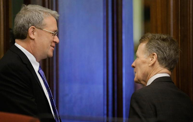 Illinois House Minority Leader Jim Durkin, R-Western Springs, left, and Illinois Speaker of the House Michael Madigan, D-Chicago, right, talk during a Pension Committee hearing at the Illinois State Capitol Tuesday, Dec. 3, 2013 in Springfield Ill. (AP Photo/Seth Perlman)