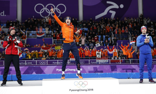 Gold medallist and new Olympic record holder Sven Kramer of The Netherlands, center, celebrates after the men's 5,000 meters race. (AP Photo)