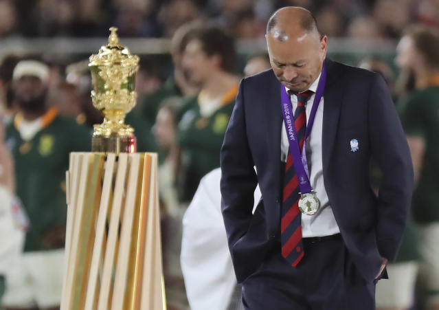 England coach Eddie Jones walks past the Webb Ellis Cup during the awarding ceremony after the Rugby World Cup final at International Yokohama Stadium in Yokohama, Japan, Saturday, Nov. 2, 2019. (AP Photo/Eugene Hoshiko)