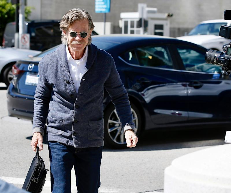 Actor William H. Macy arrives at the federal courthouse in Los Angeles, on March 12, 2019. His wife, actress Felicity Huffman, was among 50 people charged in a scheme in which wealthy parents allegedly paid bribes to get their children into elite schools. Macy was not charged.