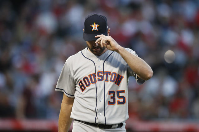 Houston Astros starting pitcher Justin Verlander adjusts his hat as he walks toward the dugout after the third inning of the team's baseball game against the Los Angeles Angels on Wednesday, May 16, 2018, in Anaheim, Calif. (AP Photo/Jae C. Hong)