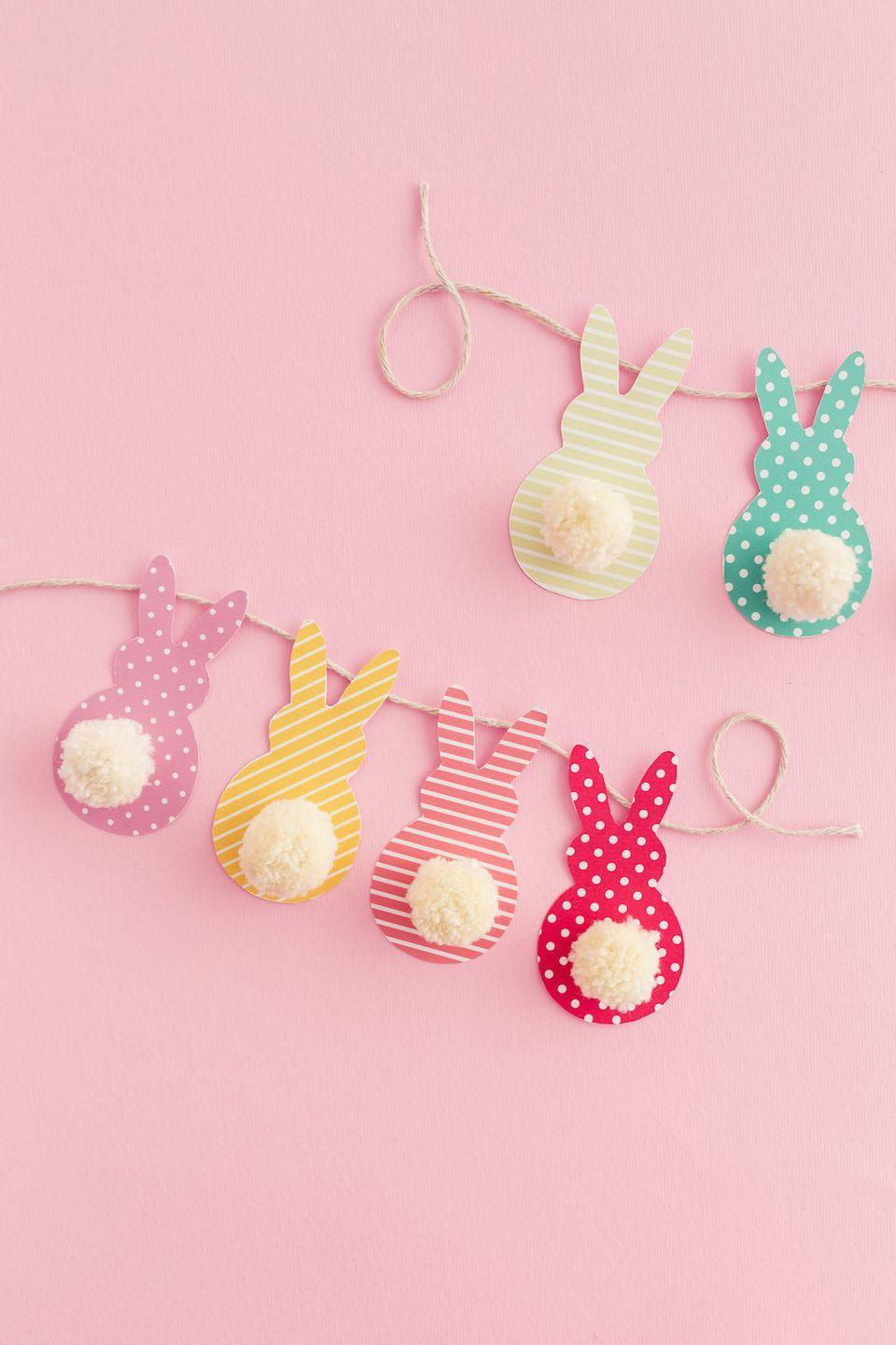 "<p>How about a homemade garland to hang in the doorway or above the dessert display at your Easter party? This free template makes it easy to create bunny shapes, and pom-poms are the perfect finishing touch.</p><p><strong>Get the tutorial at <a href=""https://diycandy.com/2017/03/pom-pom-bunny-tail-easter-garland/"" rel=""nofollow noopener"" target=""_blank"" data-ylk=""slk:DIY Candy"" class=""link rapid-noclick-resp"">DIY Candy</a>.</strong></p><p><a class=""link rapid-noclick-resp"" href=""https://www.amazon.com/Dots-Stripes-Patterned-Cardstock-Value/dp/B0761FPGY4/ref=sr_1_5?tag=syn-yahoo-20&ascsubtag=%5Bartid%7C10050.g.1652%5Bsrc%7Cyahoo-us"" rel=""nofollow noopener"" target=""_blank"" data-ylk=""slk:SHOP PAPER"">SHOP PAPER</a></p>"