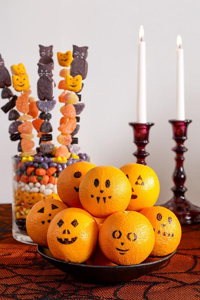 <p>Draw a classic pumpkin face on a clementine with permanent marker for the easiest (and healthiest) snack on the menu.</p>