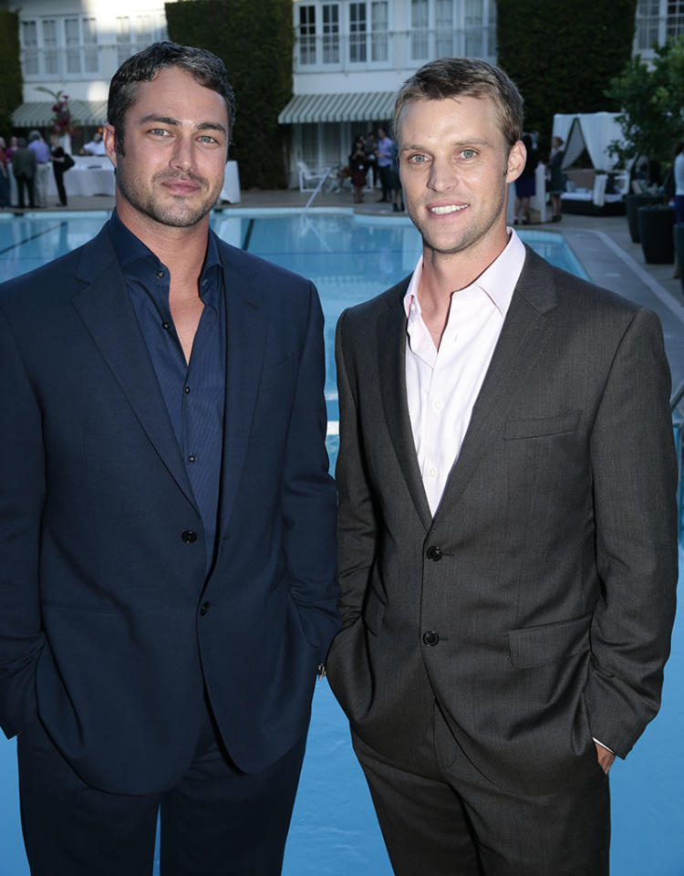 "Taylor Kinney and Jesse Spencer (""Chicago Fire"") at the NBC Cocktail Reception during the 2013 Summer Television Critics Association tour."