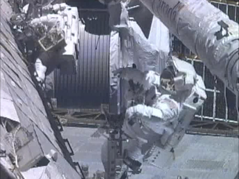 In this image from NASA television astronauts Greg Chamitoff , foreground, and Mike Fincke work outside the International Space Station repositioning the shuttle's Orbiter Boom Sensor System during the fourth spacewalk Friday morning May 27, 2011. This is the final spacewalk to be performed by shuttle crew astronauts. All future spacewalks _ including one during the final shuttle voyage this summer _ will be performed by full-time space station residents. (AP Photo/NASA)