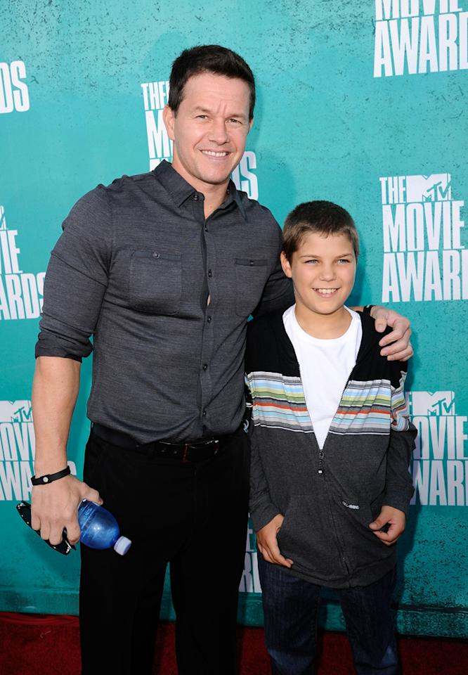 Mark Wahlberg and guest arrive at the 2012 MTV Movie Awards.
