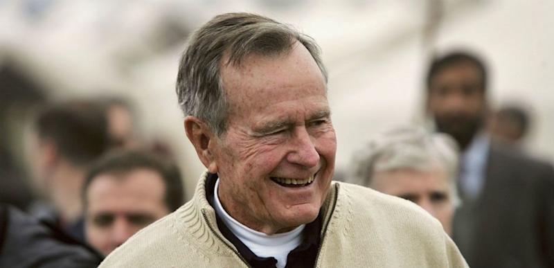 Former U.S. President George Bush visits a tent camp for earthquake survivors on the outskirts of Islamabad on January 17, 2006 in Pakistan.