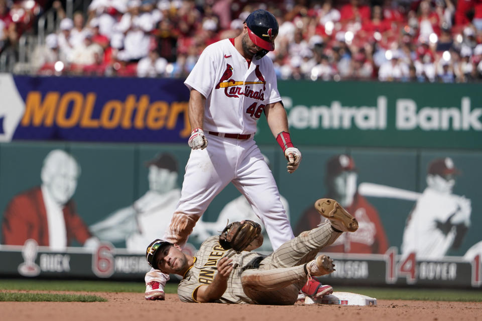 St. Louis Cardinals' Paul Goldschmidt (46) looks down after avoiding the tag from San Diego Padres second baseman Adam Frazier, bottom, for a double during the fifth inning of a baseball game Sunday, Sept. 19, 2021, in St. Louis. (AP Photo/Jeff Roberson)