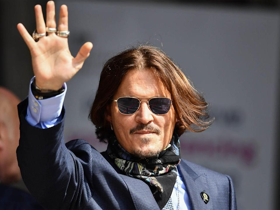 Johnny Depp arrives at the Royal Courts of Justice on July 24, 2020 at the trial suing News Group Newspapers and Sun Executive Editor Dan Wootton (Getty)