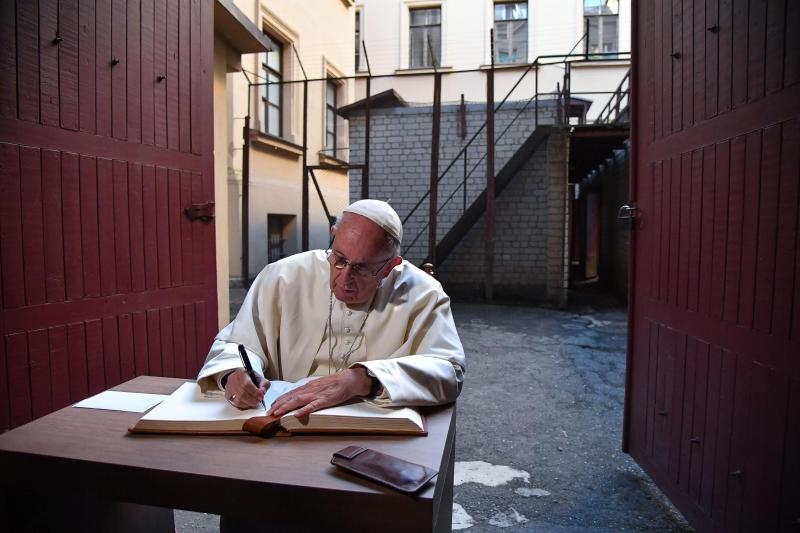 Pope Francis writes on the guestbook during his visit to the Museum of Occupations and Freedom Fights, in Vilnius, Lithuania, Saturday, Sept. 22, 2018. Francis began his second day in the Baltics in Lithuania's second city, Kaunas, where an estimated 3,000 Jews survived out of a community of 37,000 during the 1941-1944 Nazi occupation. (Alessandro Di Meo/Pool Photo via AP)