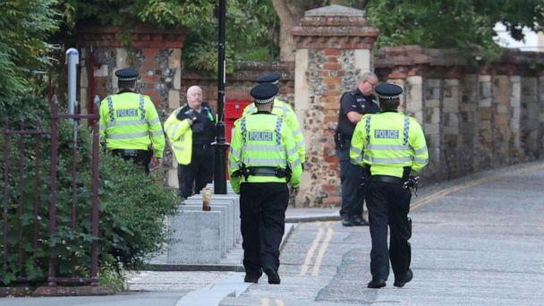 PHOTO: Police arrive at Forbury Gardens in the town centre of Reading, England, where they are responding to a 'serious incident' Saturday, June 20, 2020. (Steve Parsons/PA via AP)