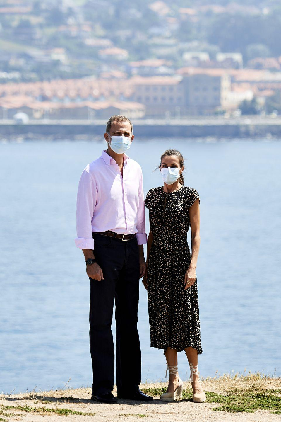 <p>Queen Letizia of Spain and her husband, King Felipe, are seen during a visit to Cerro de Santa Catalina in Gijon, marking the end of their royal tour. The Queen stepped out in a flowy black summer dress, complete with a beige speckled design. She completed the look with her signature espadrille wedges, and, of course, a medical mask. </p>