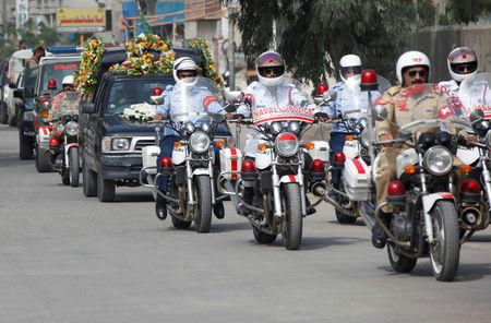 Pakistan's military, naval and air force police officers escort the hearse carrying the coffin of the German-born Sister Dr. Ruth Pfau, during her funeral in Karachi, Pakistan August 19, 2017. REUTERS/Akhtar Soomro