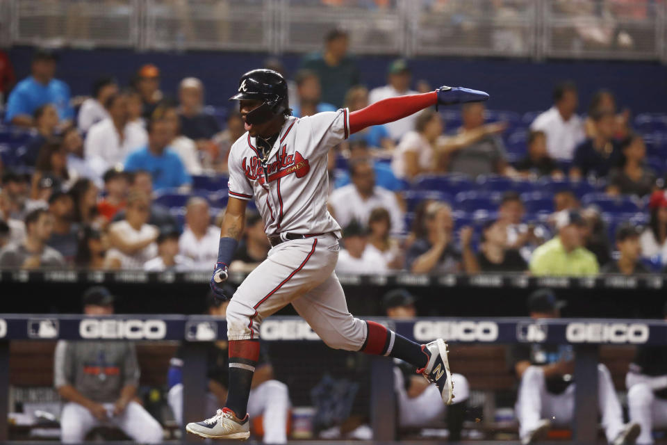 Atlanta Braves' Ronald Acuna Jr. celebrates as he scores during the eighth inning of a baseball game against the Miami Marlins, Saturday, Aug. 10, 2019, in Miami. (AP Photo/Brynn Anderson)
