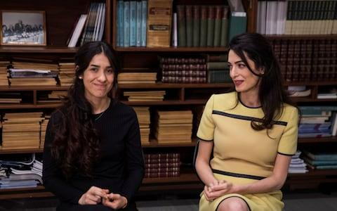 Yazidi survivor Nadia Murad takes part in an interview with international human rights lawyer Amal Clooney at United Nations headquarters in New York - Credit: Reuters