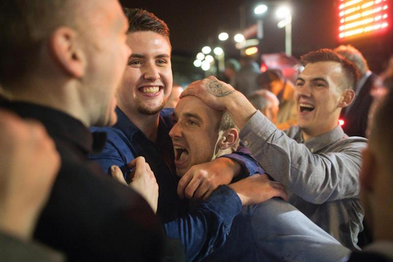 Lucky night: punters celebrate their win (AFP/Getty Images)