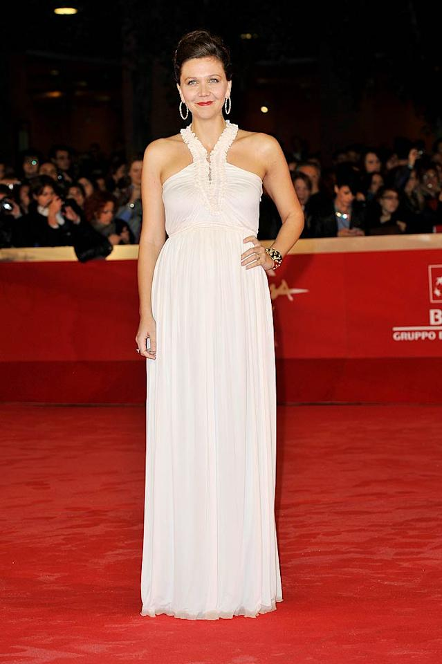 And last, but not least, we have Maggie Gyllenhaal, who was a vision in her white Alexander McQueen Spring 2012 creation -- featuring a ruffled halter neckline -- at the Rome Film Fest. Judging from her smile, Maggie knows she looks good! (10/28/2011)