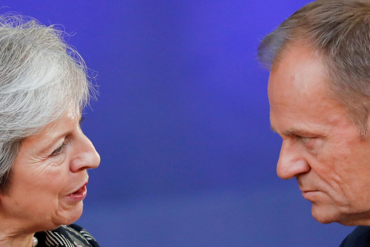 European Council President Donald Tusk and Britain's Prime Minister Theresa May talk as they arrive for a group photo at the ASEM leaders summit in Brussels, Belgium October 19, 2018. REUTERS/Yves Herman       TPX IMAGES OF THE DAY