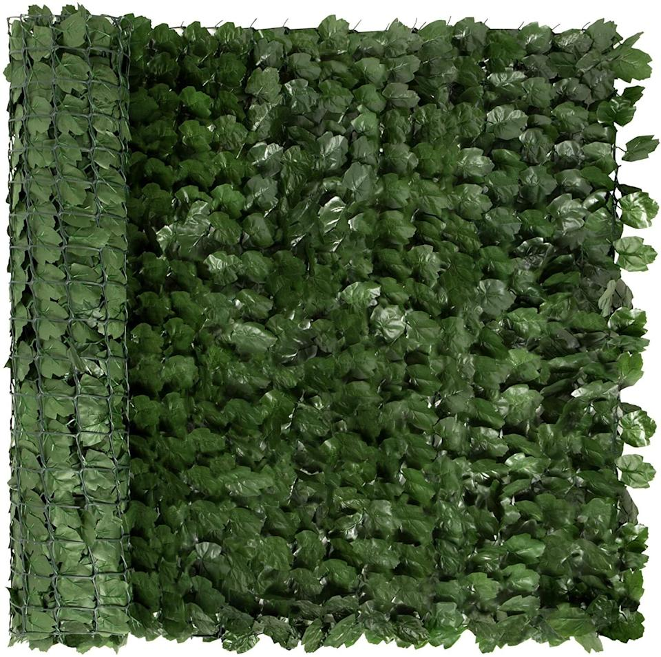 """Transform your outdoor space into a soothing """"green"""" haven with plenty of privacy. You'll get 94x39 inches of this faux material, which is water-resistant and easily wraps around railings.<br /><br /><strong>Promising review:</strong>""""I am on the third floor and I wanted privacy on my parking lot facing balcony while sungazing.<strong>This fit the bill perfectly for me, the zip ties only took a few minutes to attach from the inside I did not attach to outside.</strong>"""" —<a href=""""https://amzn.to/3tJgWNZ"""" target=""""_blank"""" rel=""""nofollow noopener noreferrer"""" data-skimlinks-tracking=""""5580838"""" data-vars-affiliate=""""Amazon"""" data-vars-href=""""https://www.amazon.com/gp/customer-reviews/R6EQ667X7SVH3?tag=bfgenevieve-20&ascsubtag=5580838%2C12%2C33%2Cmobile_web%2C0%2C0%2C1159974"""" data-vars-keywords=""""cleaning,fast fashion,skincare"""" data-vars-link-id=""""1159974"""" data-vars-price="""""""" data-vars-product-id=""""16176844"""" data-vars-retailers=""""Amazon"""">Amazon Customer</a><br /><br /><strong>Get them from Amazon for <a href=""""https://amzn.to/32LMZAN"""" target=""""_blank"""" rel=""""noopener noreferrer"""">$52.99+</a> (available in three sizes).</strong>"""
