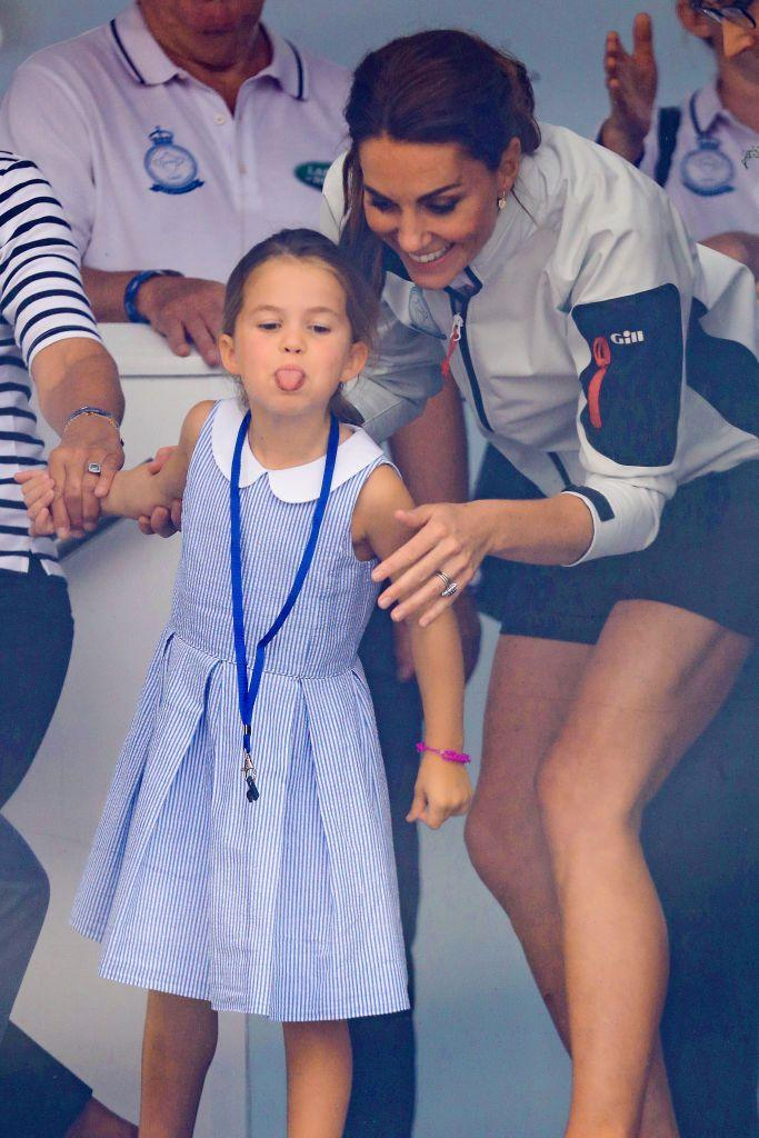 """<p>After supporting her mother and father at a sailing regatta for charity on the Isle of Wight, Charlotte poked her tongue out for photographers - <a href=""""https://www.elle.com/uk/life-and-culture/a28654947/princess-charlotte-stick-out-tongue-prince-harry/"""" rel=""""nofollow noopener"""" target=""""_blank"""" data-ylk=""""slk:channelling her Uncle Harry"""" class=""""link rapid-noclick-resp"""">channelling her Uncle Harry</a> - in August 2019.</p>"""