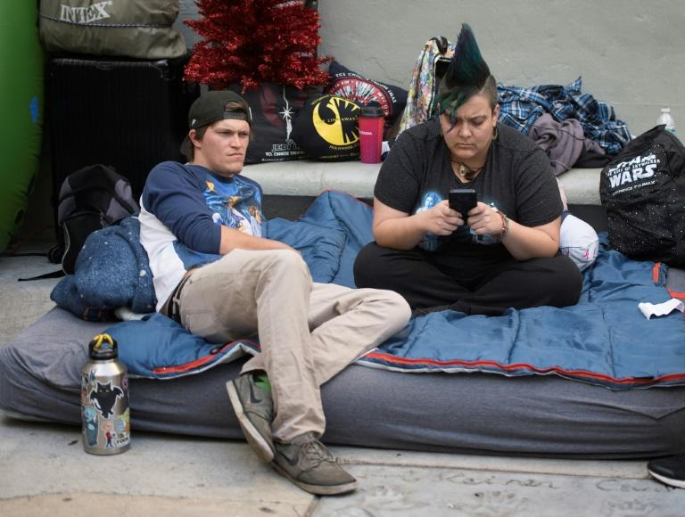 """Star Wars fans wait outside the TCL Chinese Theater one week before the release of """"Star Wars: The Rise of Skywalker"""" movie in Hollywood, California on December 12, 2019"""