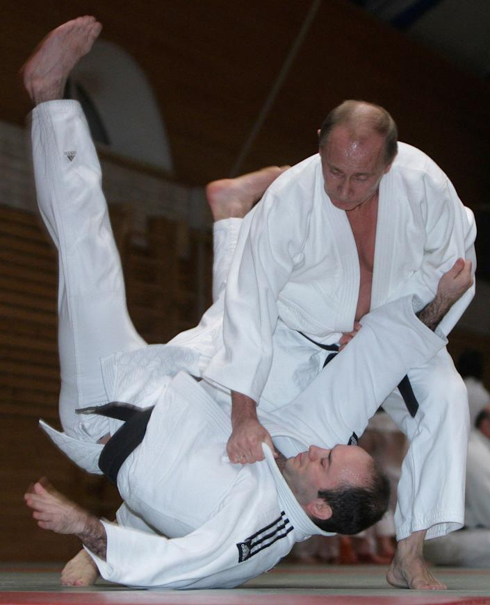 Putin shows off his judo skills in St. Petersburg, Russia, on Dec. 18, 2009.