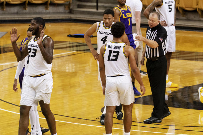The referee tries to calm emotion after Missouri's Jeremiah Tilmon, left, was fouled during the first half of an NCAA college basketball game against LSU Saturday, March 6, 2021, in Columbia, Mo. (AP Photo/L.G. Patterson)